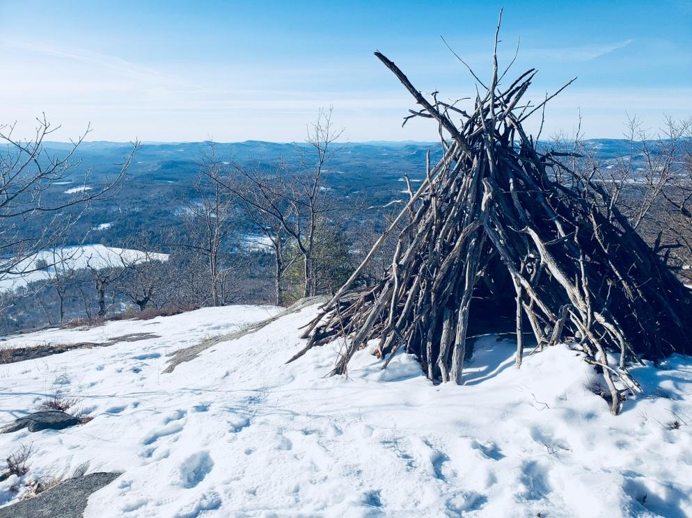 Wood teepee near Southwest Summit, Pleasant Mountain