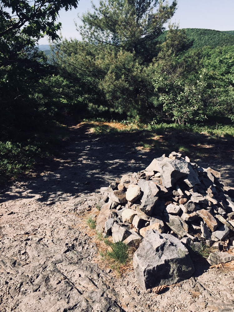 A cairn marks the descent from the North Peak to the Twin Brook Trail