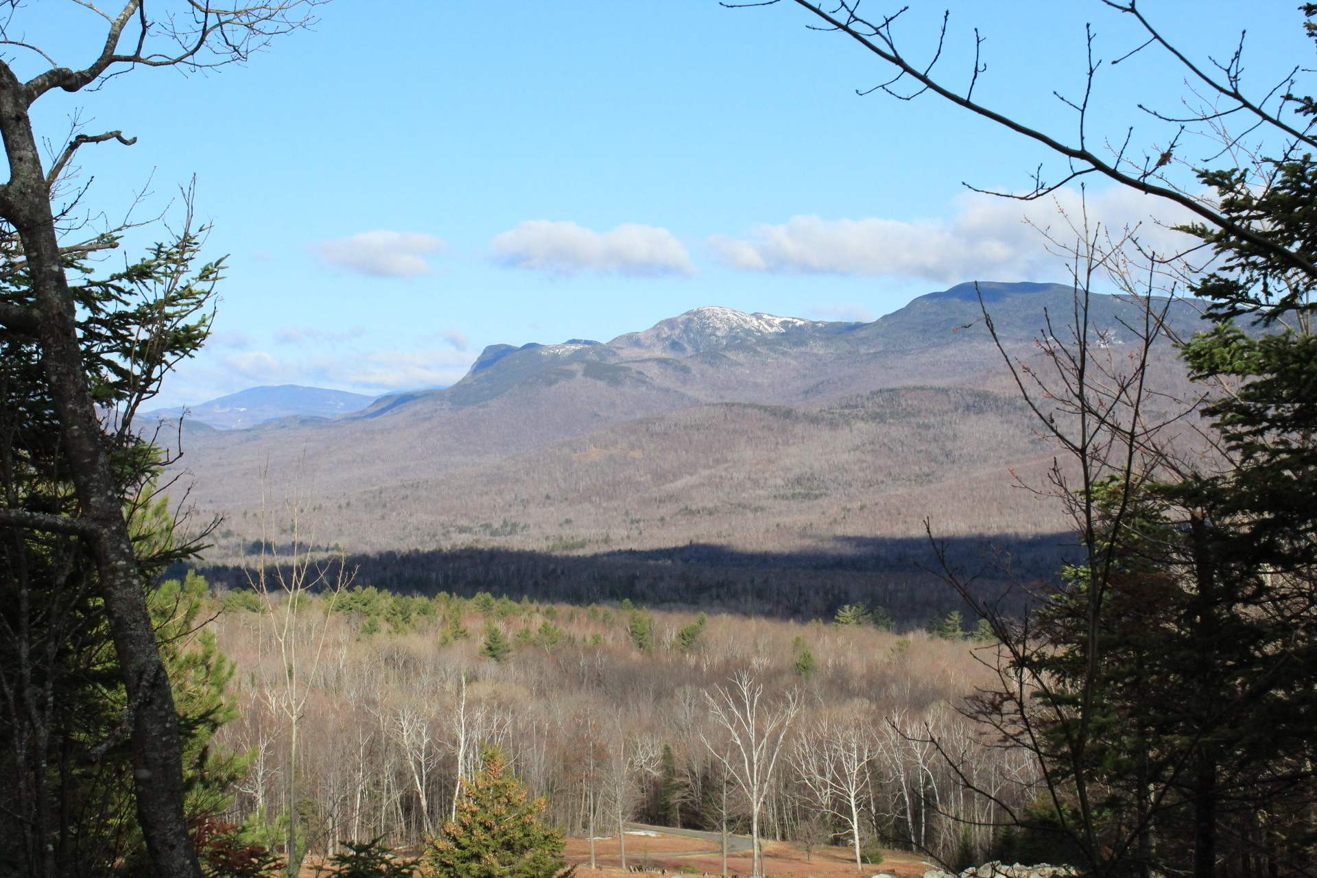 View through the trees of Tumbledown, Little Jackson, and Jackson Mountains from Center Hill Nature Trail, Mount Blue State Park, Weld, Maine.
