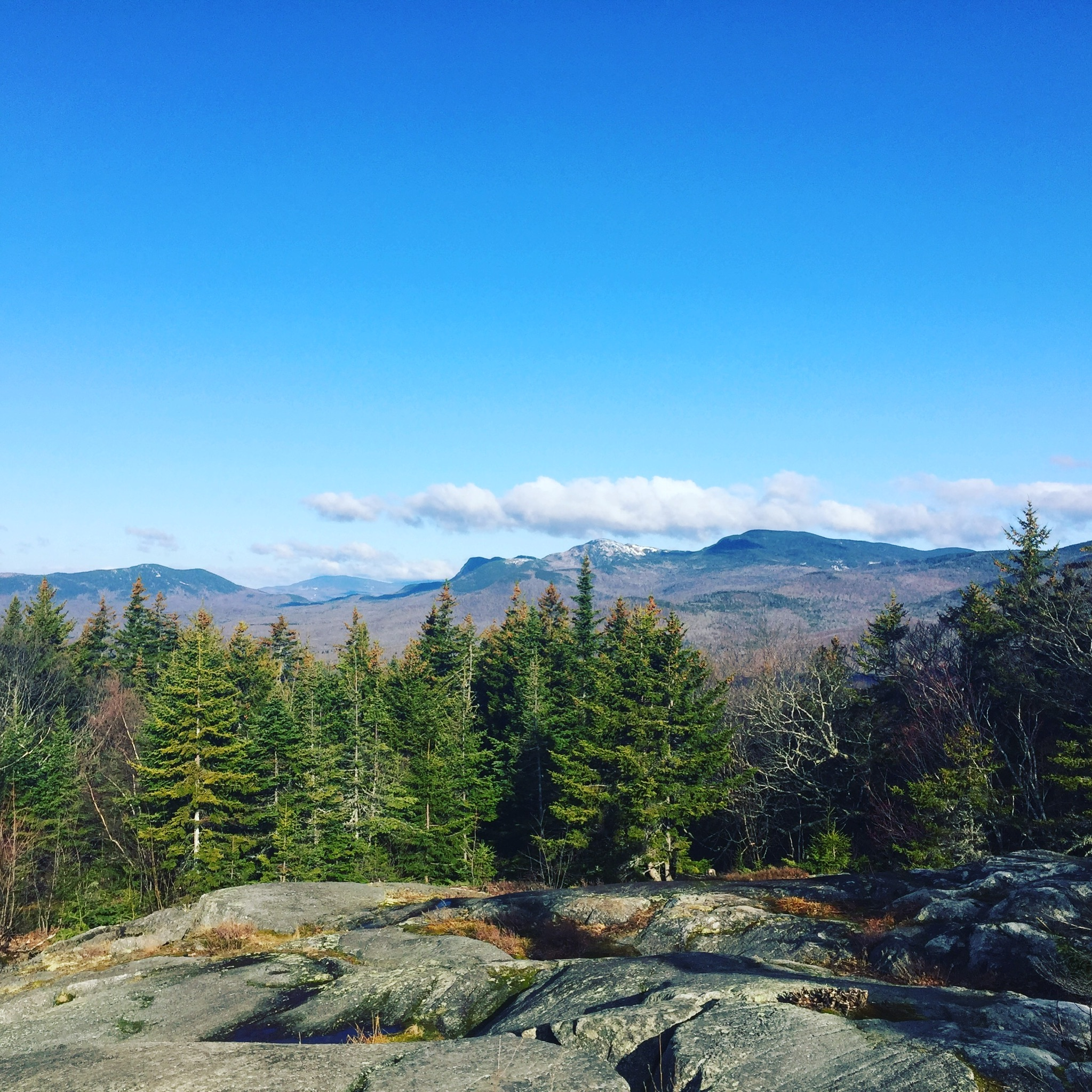 View of (right to left) West, Old Blue, Tumbledown, Little Jackson, and Jackson Mountains from Center Hill Nature Trail, Mount Blue State Park, Weld, Maine.